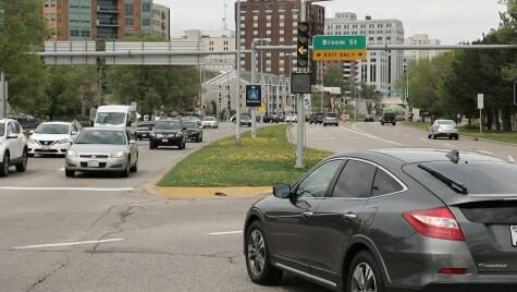 Photo: Car waiting to turn left at busy intersection
